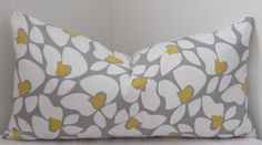 Pillow cover designed to fit an insert 14x24.    Colors include white, grey and yellow Same fabric on both sides.  Invisible zipper for easy