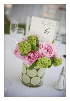 except with orange ranunculas (?i think that's the spelling) rather than pink peonies - or white peonies