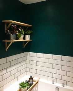 New gorgeous dark green bathroom using Deep Sea Green by Valspar Paint, Ikea Erkby shelf brackets and Topps Tiles Metro tiles. Picture owned by @bethie.tricks