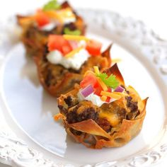 Taco Cupcakes~  Place 2 wonton wrappers in each sprayed muffin tin, (1 if using mini cupcake pan) fill it halfway with taco seasoned ground meat and cheese.  Bake for 10-15 mins on 350 or until cheese is melted and wontons are golden brown. Top with tomato, lettuce, salsa, onions, black olives,sour cream and guacamole.  Great for kids, appetizers or part of your dinner!