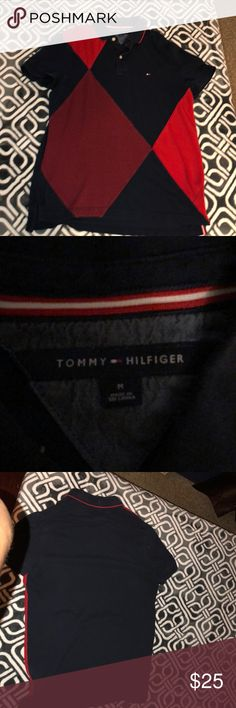 Tommy Hilfiger Polo Selling this navy blue and red polo used but in fair condition if my price doesn't seem correct make an offer Tommy Hilfiger Shirts Polos