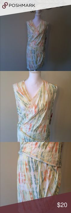 """French Connection sleeveless Dress Super cute French Connection sleeveless tie dye-ish dress. Shades of yellow, orange, green, and blue, and white. Top is a drape/V neck that wraps to the side. There is also a slit in the side on the bottom. Both are in the photos. Bust flat roughly 21"""", waist flat roughly 18.5"""", hip flat roughly 22"""". You will need a slip or cami dress under this. You can't see through the front but in certain light you can kind of see through the back. French Connection…"""