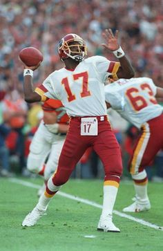 Washington Redskins QB, Doug Williams, would be the first African American QB to play in the Super Bowl. He would also be the first African American QB to, not only win the Super Bowl, but also to be named MVP of the Super Bowl. Redskins Players, Redskins Fans, Redskins Football, Nfl Football Players, Football Helmets, Nfl 49ers, Football Season, Washington Redskins, Super Bowl