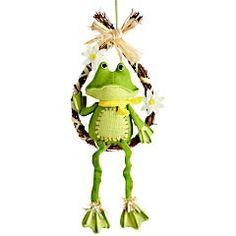 Cute wreath for spring with a frog sitting on it