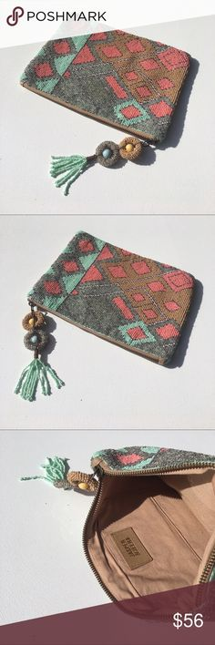 "Anthropologie Jasper and Jeera Beaded Clutch Beautiful double sided, hand beaded, Aztec clutch by Jasper and Jeera for Anthropologie. This clutch is 8""H x 10.5""W, and features a zipper closure with beaded tassel, 4""H x 5""W open interior pocket, and a soft, sand colored lining. It is brand new condition, never used, no missing beads or damage. Anthropologie Bags Clutches & Wristlets"