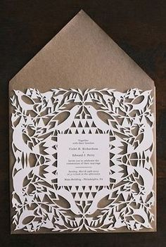 Laser cut wedding invitations | photo by Love Me Do | 100 Layer Cake
