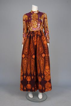 LOT 812   RONALD AMEY PRINTED and SEQUINED EVENING DRESS, 1970s.