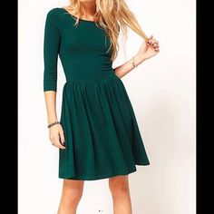 Perfect Christmas dress Wemon a size large  3/4 sleeve dark green 100% cotton very warm thick material .. Fits small I would say it truly a small medium dress only would make a perfect Christmas dress with the right accessories .. I wore it last X- Mas with black tights and a gold belt Dresses Long Sleeve