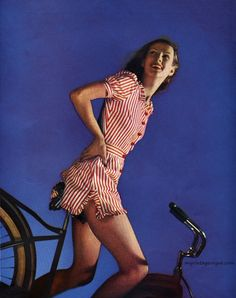 40s red white striped playsuit shorts summer casual active wear color photo print ad model bicycle Harper's Bazaar May 1943 - photo by George... | myvintagevogue