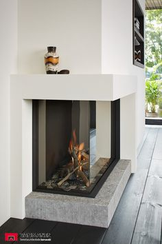 Top 70 Best Corner Fireplace Designs - Angled Interior Ideas Don't have the full for a full-scale fireplace? Discover the top 70 best corner fireplace designs featuring luxury angled interior ideas and inspiration. Modern Fireplace Decor, Corner Fireplace Mantels, Fireplace Furniture, Bedroom Fireplace, Home Fireplace, Living Room With Fireplace, Fireplace Design, Fireplace Ideas, Mantel Ideas