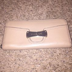 Authentic Michael Kors Wallet Tan with a gold buckle on the front. Used a couple times, but still in great condition! Bags Wallets