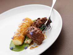 Malt glazed pig's cheeks with confit cod belly bon bon , chive sauce