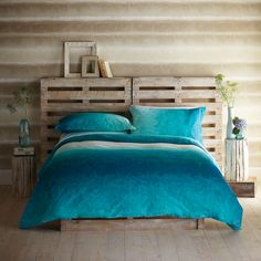 Pallet Headboard - This could work in our room b/c the openings would let air circulate.