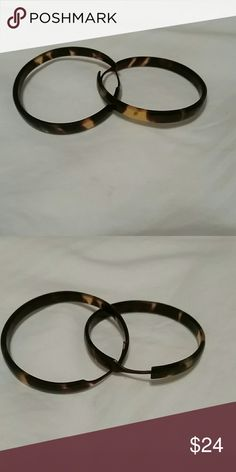 Tortoise shell hoop earrings Natural tortoise shell, with no metal. The entire hoop is natural shell so great for people with metal allergies. 1.5 - 1.75 inch diameter. Hand carved in Mozambique. Jewelry Earrings