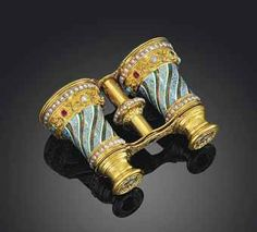 A pair of Swiss gold and jewelled enamelled opera glasses, Geneva, circa 1840, sold for £20,000 at Christie's.