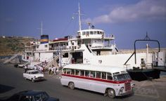 Day trip to Gozo: A group of tourists make their way from the bus to the ferry as the Cittadella sits in Gozo's Mgarr Harbour in 1990