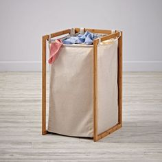 Shop Clean and Simple Hamper (Single).  This neutral canvas hamper doesn't have any fancy bells or whistles.  It's simply designed to easily blend in with any décor and help keep your home looking a little cleaner.