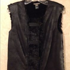 "Faux Fur Vest A black reversible faux fur and faux suede vest. Made of polyester. 42"" bust and shoulder to hem of 25"". Marked a Medium but would work for a L/XL. Spanner Tops"