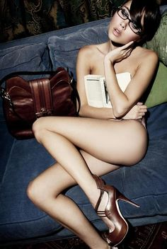 reading is sexy - she is obviously reading erotica and liking it!!