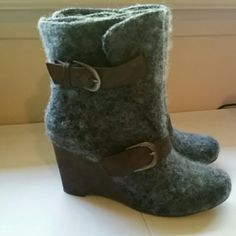 """Gray Wool Mukluk Boots Dark gray wooly Mukluk wedge boots woth brown faux leather straps and buckles. Water resistant. Heel is 3.5"""". Never worn, only tried on a time or two. I just can't make them work with my wardrobe. Mukluk Shoes Ankle Boots & Booties"""