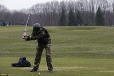A man wearing a kevlar vest and combat trousers plays golf on ousted Ukraine President Viktor Yanukovich's  private course. Citizens roamed the grounds after he fled into hiding, although they formed a volunteer watch so no looting or damage was done. That's awesome, and I can't tell you how much I love this picture. Power to the people.