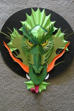 Make a Cardboard Dragon!: I used cardboard to make this art piece. Look at the pictures and view the image notes to see how it was constructed. Dragon Birthday, Dragon Party, Cardboard Sculpture, Cardboard Art, Paper Mask, Paper Clay, Kirigami, Enchanted Forest Book, Dragon Mask