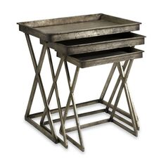 A trio of tin tray tables is finished in silver leaf for just the right amount of sheen. Set includes: Three (3) leaf tray tables Materials: 100-percent Tin Food Safe: No Outdoor safe: No Weight: 25.0