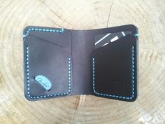 Wallet with a plectrum slot