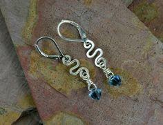 Aquamarine Swarovski Crystal & Silver Earrings. #Jewelry #Earrings #Necklace #Bracelet #Bangle #rings #Silver #Sterling #Gems #Jewels #Quartz #Rubies #Garnet #Amethyst #Turquoise #Swarovski #Tourmaline #Rubilite #Wirewrap #Handtied  www.cariboudenver.com