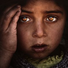 If you look closely, you can see the photographer reflected in the childs eyes / photography by ~spartakustum on deviantART