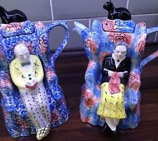 SWINESIDE CERAMICS COUPLE SITTING IN ARMCHAIRS WITH CATS TEAPOTS