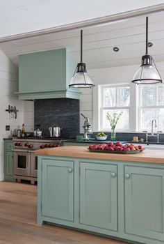 I like the mix of butcher block and granite counter top. Turquoise is interesting with the white.