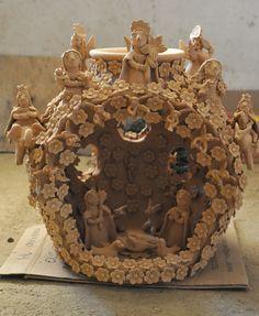 Nativity scene enclosed within a large decorated olla. By Irma Garcia Blanco of Santa Maria Atzompa. Oaxaca, Mexico