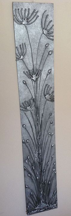 Hot Glue Gun Art - Spray painted with Metallic Silver, distressed with black paint - giving it an antique metal look.: by mai