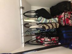 Used a tension rod and shower curtain hooks in an under the stairs closet for hanging bags :)