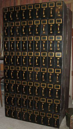 A wall of drawers. Magnificent cabinet fittings in brass, drawer handles and label holders.