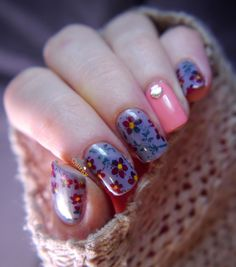 Floral nail art stamping using MoYou Pro Collection stamping plates. The shell detail on the accent nail is super cute!