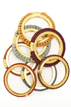 love these woven leather bangles by Lizzie Fortunato