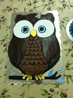 Mr. Owl is 1yr old - This owl cake was made for a one year old's birthday.  I hand carved it from a full sheet cake pan. Decorated with buttercream icing and fondant.