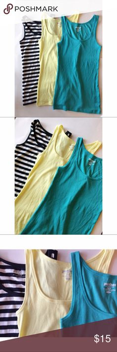 """Old Navy Perfect Tank Bundle ON """"perfect"""" tank bundle. Excellent used condition! Teal, yellow, & black & white stripes. See photos for measurements. All three are size medium. However IMO they run smaller like an XS SMALL. (I'm not responsible for wrong fit. Please ask questions prior to purchasing. & remember my opinion on sizing is just my opinion because all of our bodies are unique.) Old Navy Tops Tank Tops"""