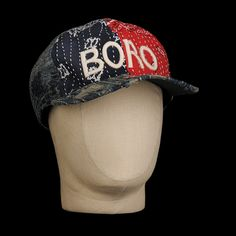 """-Made in Japan. This amazing hat is made of a purposefully distressed and reworked bandana boro fabric as part of Kapital's """"Kountry"""" collection, and features a stitched """"BORO"""" decal, red tab and rivet sticker on the brim and six panel design. -90% cotton, 10% linen. -Distressed boro..."""