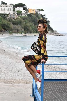 Wearing a pasta print dress, Zendaya Coleman poses behind-the-scenes at Dolce & Gabbana's spring 2017 campaign
