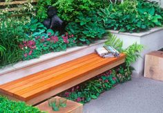 If you need extra seating in your small garden, a good space-saving solution is to incorporate a bench with raised beds along a boundary.