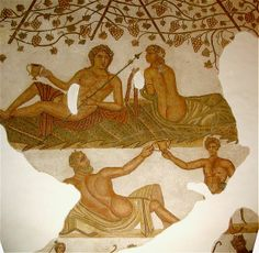 Bacchus, Ariadne, and satyr Silenus. Roman floor mosaic in the Bardo Museum in Tunis. Second century A.D.