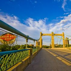 Hennepin Avenue Bridge in Minneapolis next to Grain Belt Beer Sign   You'll Want To Cross These 13 Amazing Bridges In Minnesota