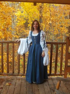 Author Jennifer Hudson Taylor in 15th century Highland gown by Autumn trees in Gatlinburg, TN.