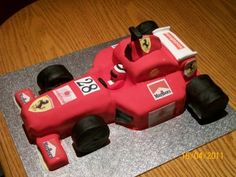 Homemade Formula One Birthday Cake: This Formula One Birthday Cake was made for my son's best friend who is a motor mechanic and loves Formula 1 racing. The cake was made from Madeira Diy Birthday Cake, First Birthday Cakes, Boy Birthday, Ferrari Cake, Ferrari Party, Unique Cakes, Creative Cakes, Caravan Cake, Cars Theme Cake