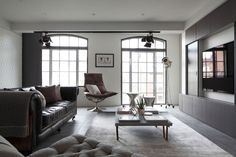 Sophisticated Industrialism Revealed In A London Apartment homedit.com