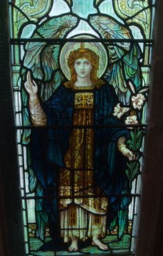 Archangel Gabriel, Detail of a window in the south aisle at St Laurence's, Meriden c1910. By James Powell & Sons of London, probably designed by J.W.Brown.
