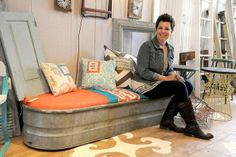 Rust & Found owner Becky Dunn sits on a repurposed watering trough into a upholstered bench.